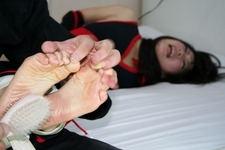 Feet soles tickling photos of Sara